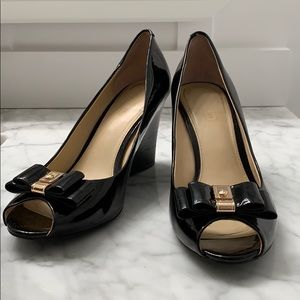 Coach black patent leather wedge heels